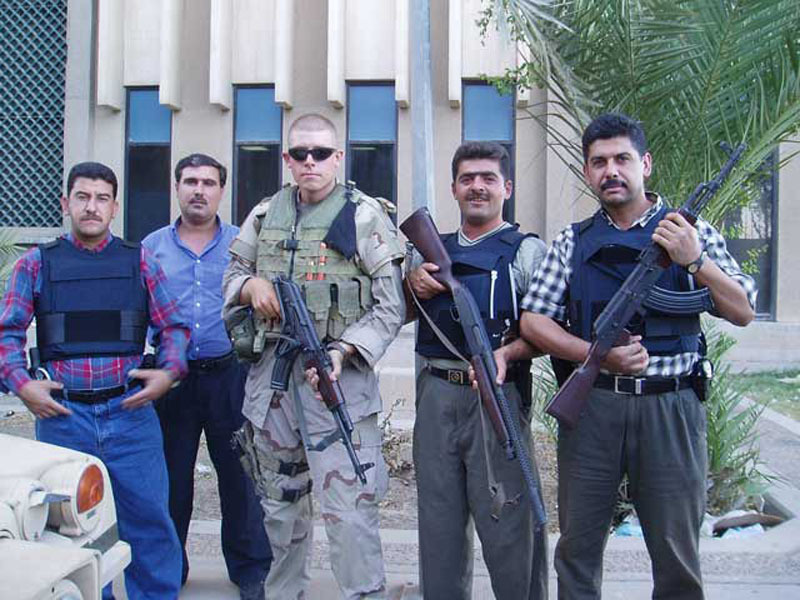 Daniel Somers and Iraqi Police with whom he was embedded for much of the heaviest fighting in Iraq. (PRNewsFoto/Project Shai)
