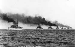 Image of U.S. Atlantic Fleet Battleships, steaming out of Hampton Roads, VA. , in December 1907, to begin their cruise around the World. Leading two ships are: Kansas (BB-21) and Vermont (BB-22). NH 92091