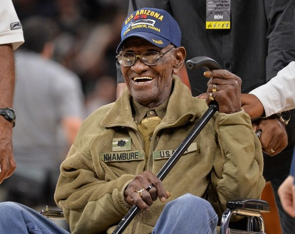 Richard Overton, shown in March 2017, leaves the court after a special presentation honoring him as the oldest living American war veteran, during a timeout in an NBA basketball game between the Memphis Grizzlies and the San Antonio Spurs. The Army veteran died Dec. 27, 2018, at a rehab facility in Austin. (Darren Abate/AP)