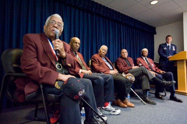 Thomas Ellis, left, joins his fellow Tuskegee Airmen as they answer questions from the audience during an event at Joint Base San Antonio-Randolph Air Force Base, Texas, Feb. 8, 2010. (Steve Thurow/Air Force)